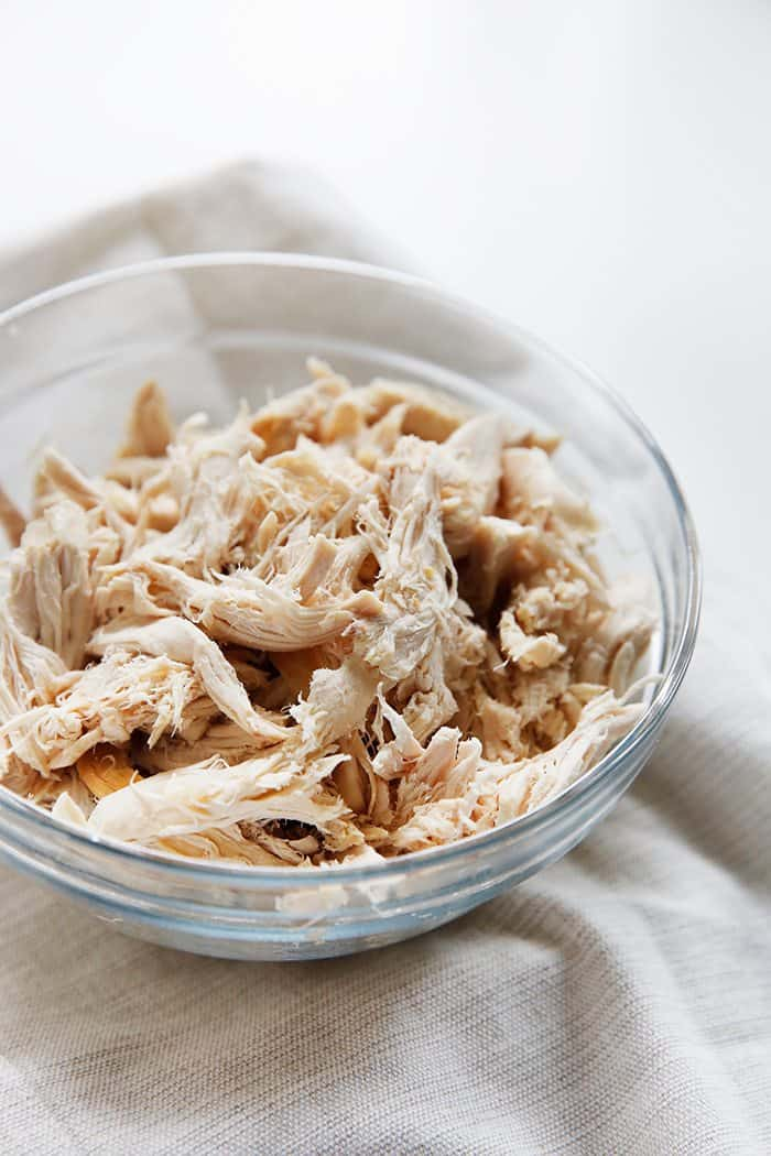 A bowl of shredded chicken.