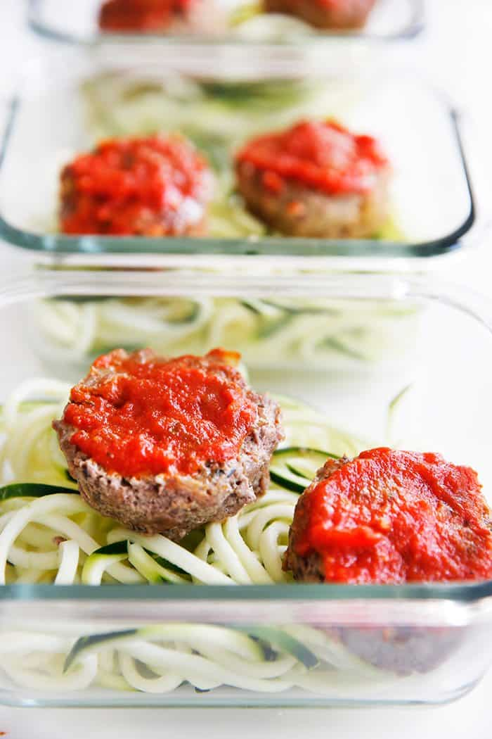 Paleo mini meatloaf muffins with tomato sauce on them