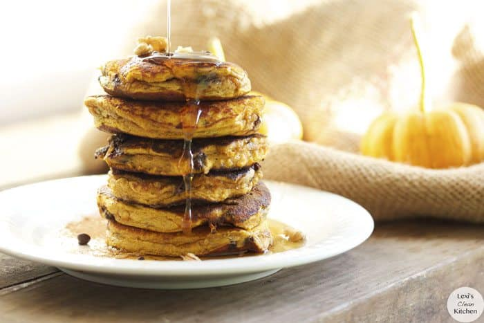 Chocolate Chip Pumpkin Protein Pancakes with a drizzle of maple syrup.