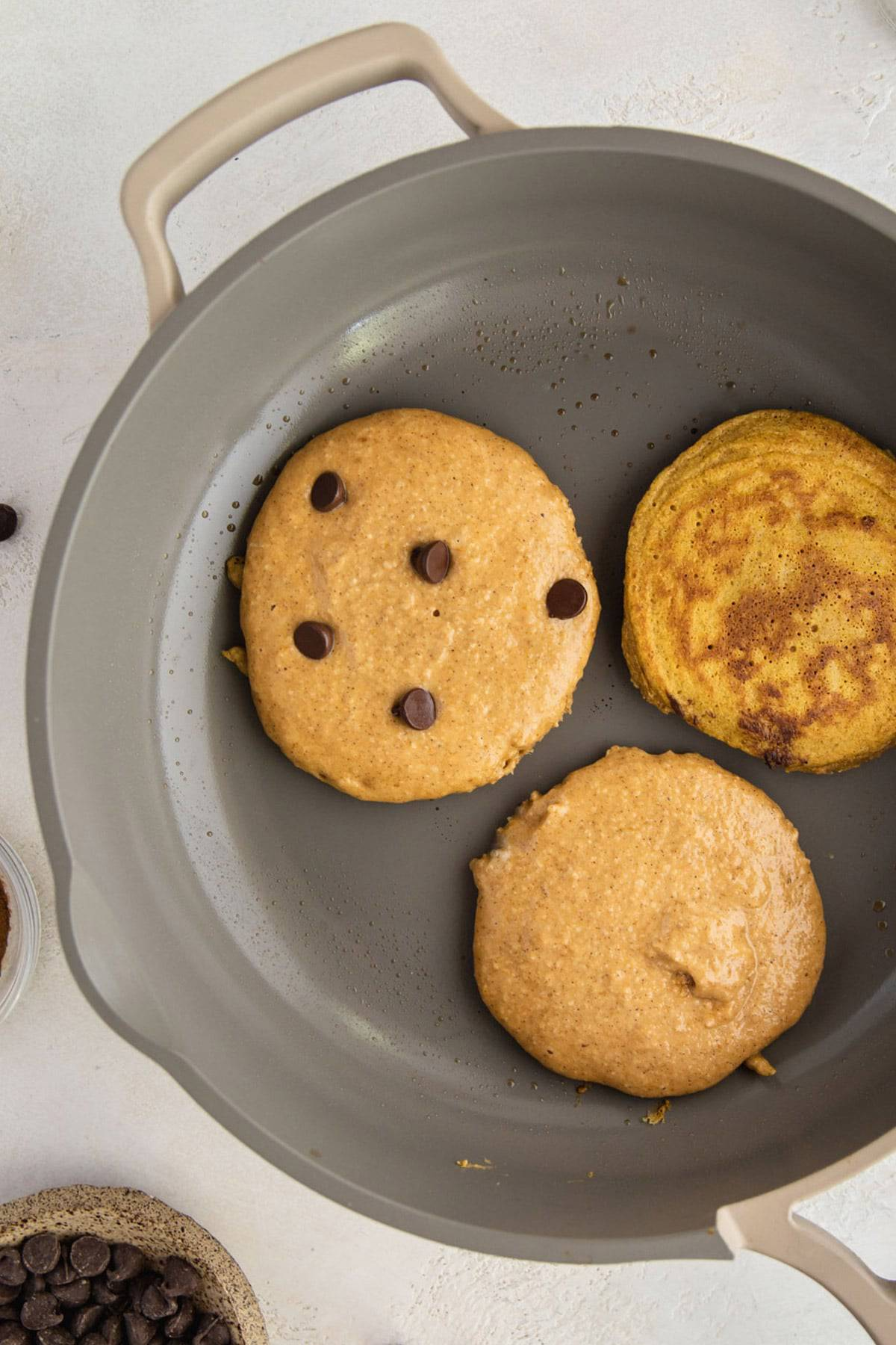 Paleo pumpkin pancakes in a skillet.