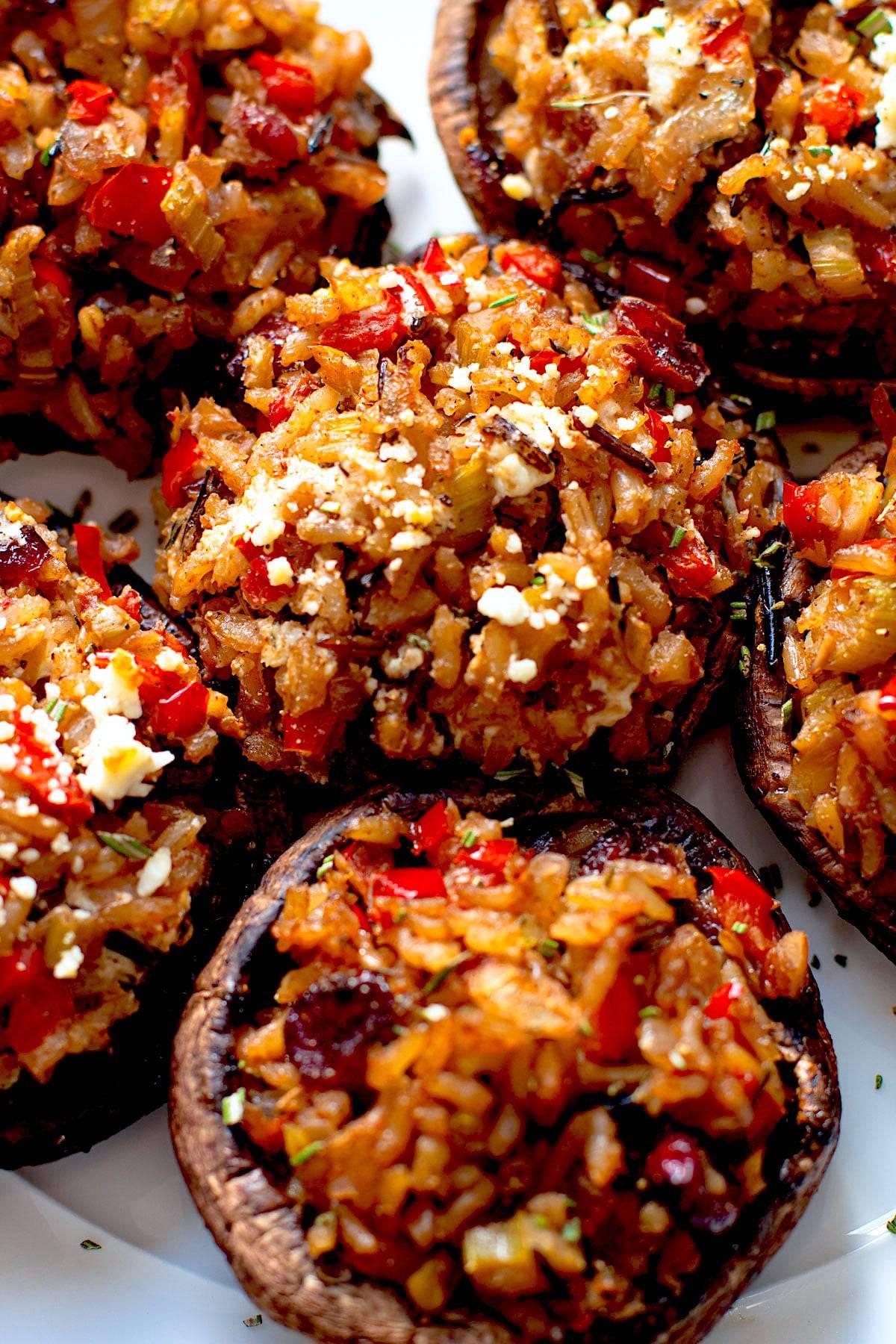 Vegetarian stuffed mushrooms on a plate.