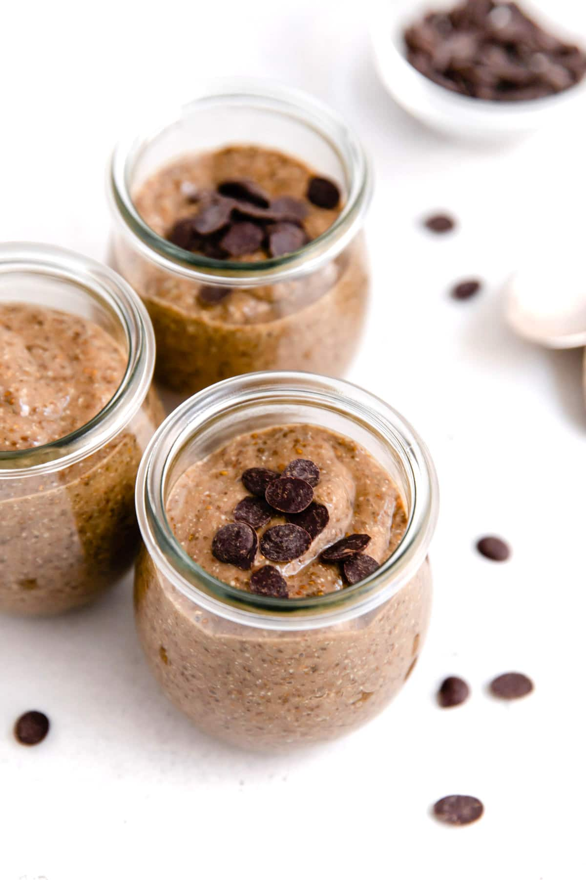 Small jars of chocolate chia seed pudding.