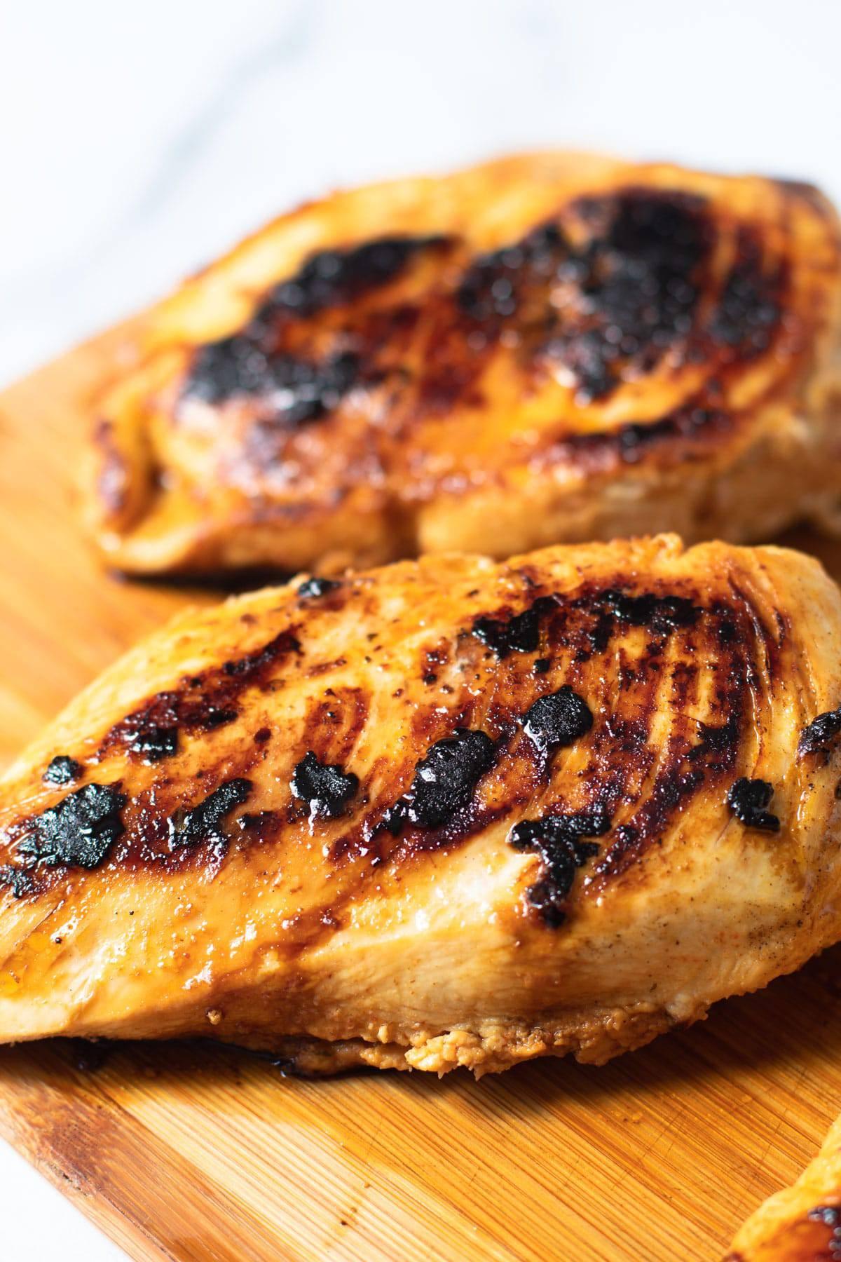 Pan seared chicken breasts for fajita salad.