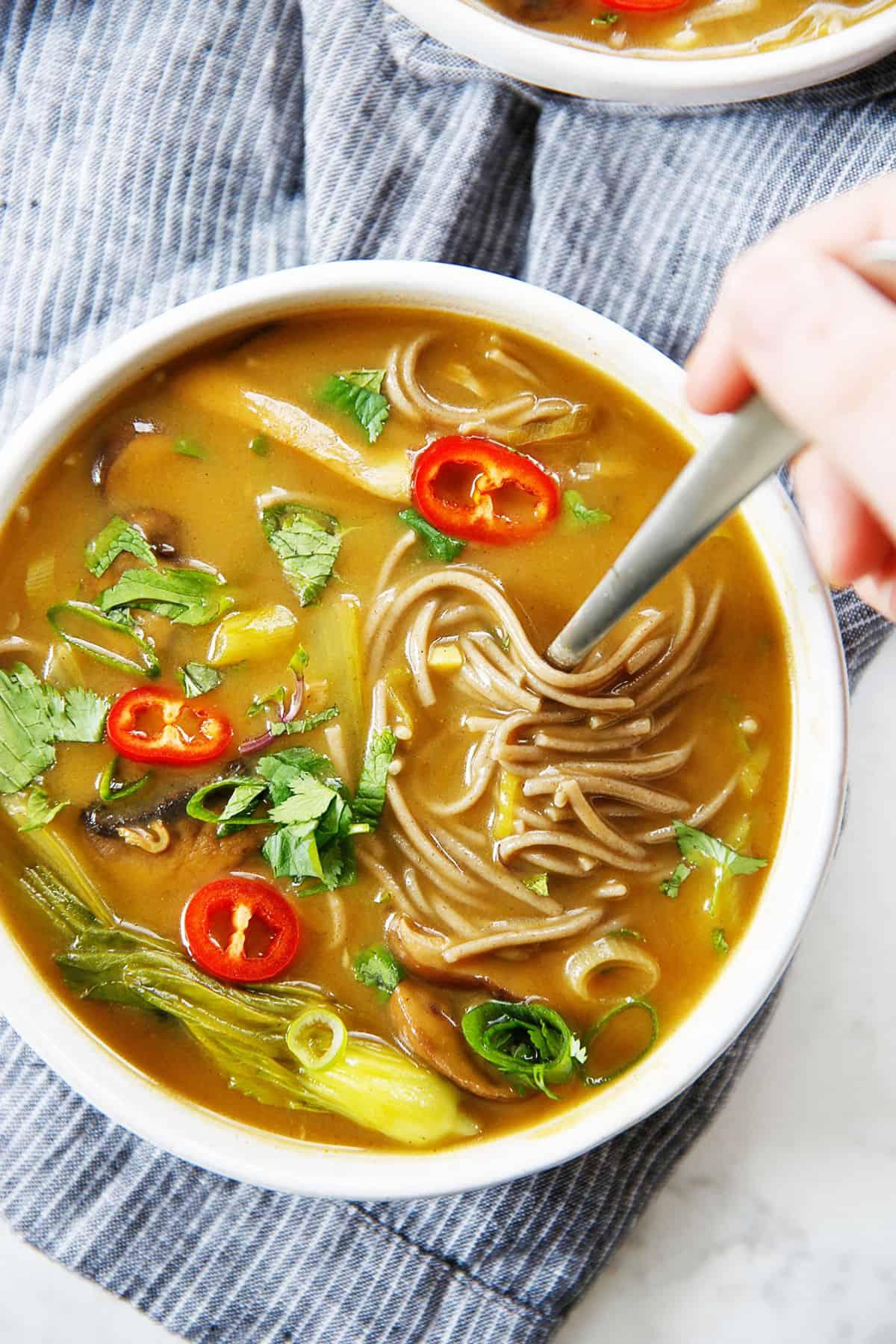 A bowl of spicy noodle soup.
