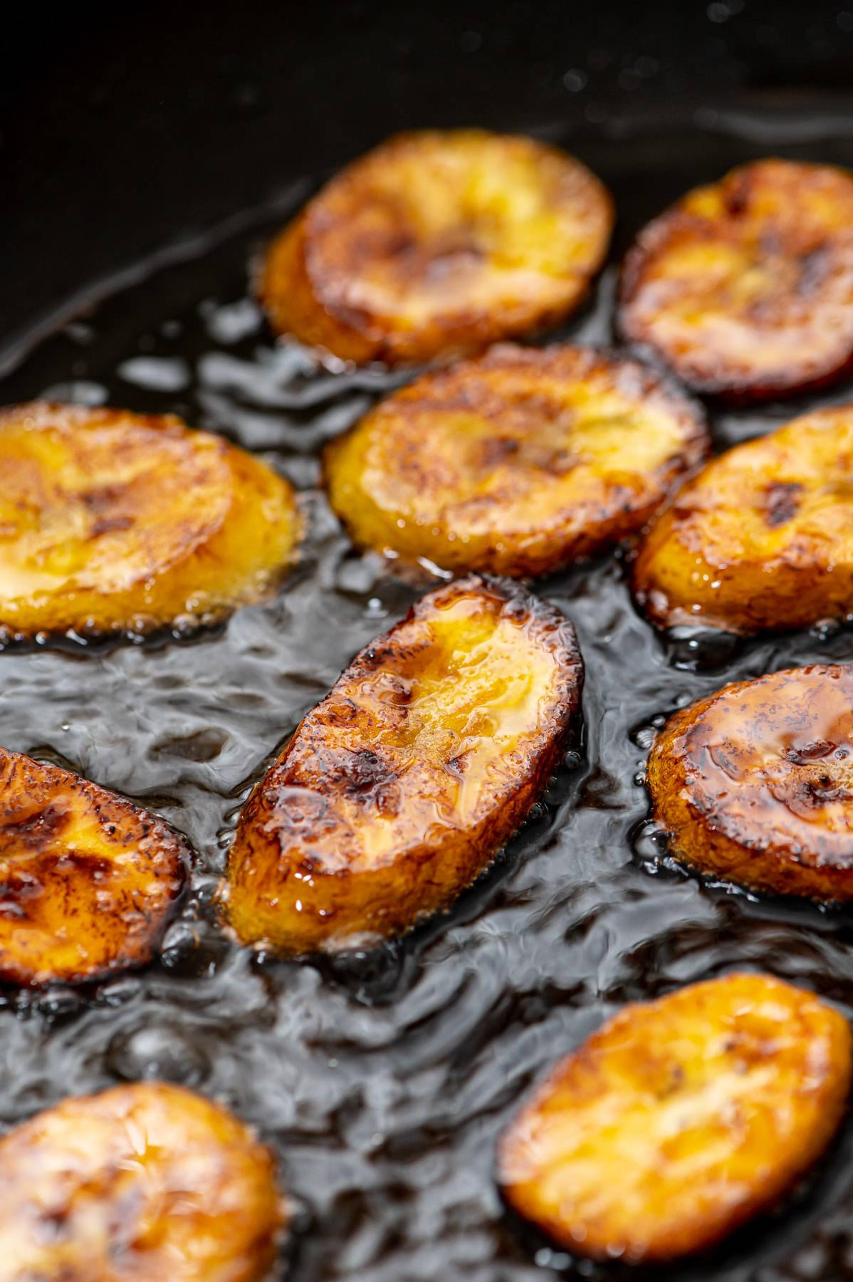 Frying plantains.