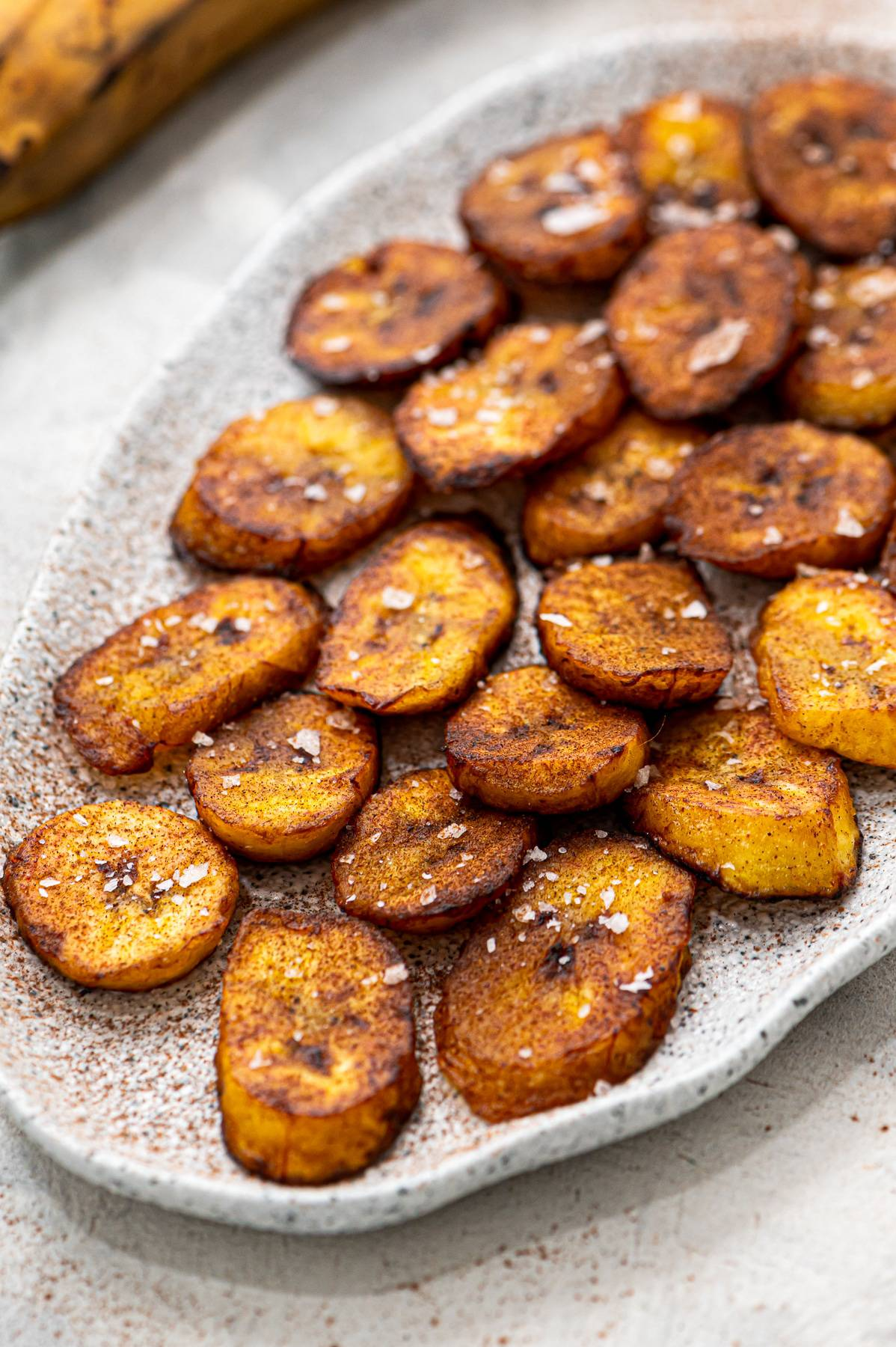Fried sweet plantains on a plate.