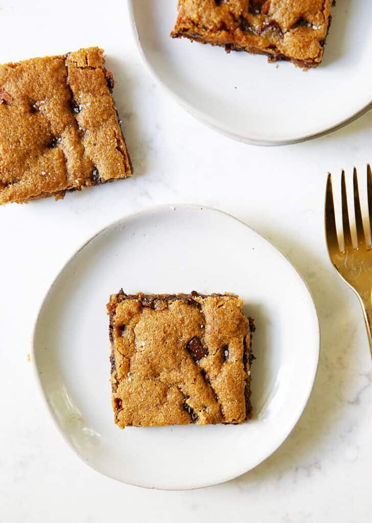 Gluten free chocolate chip cookie bars on a plate.