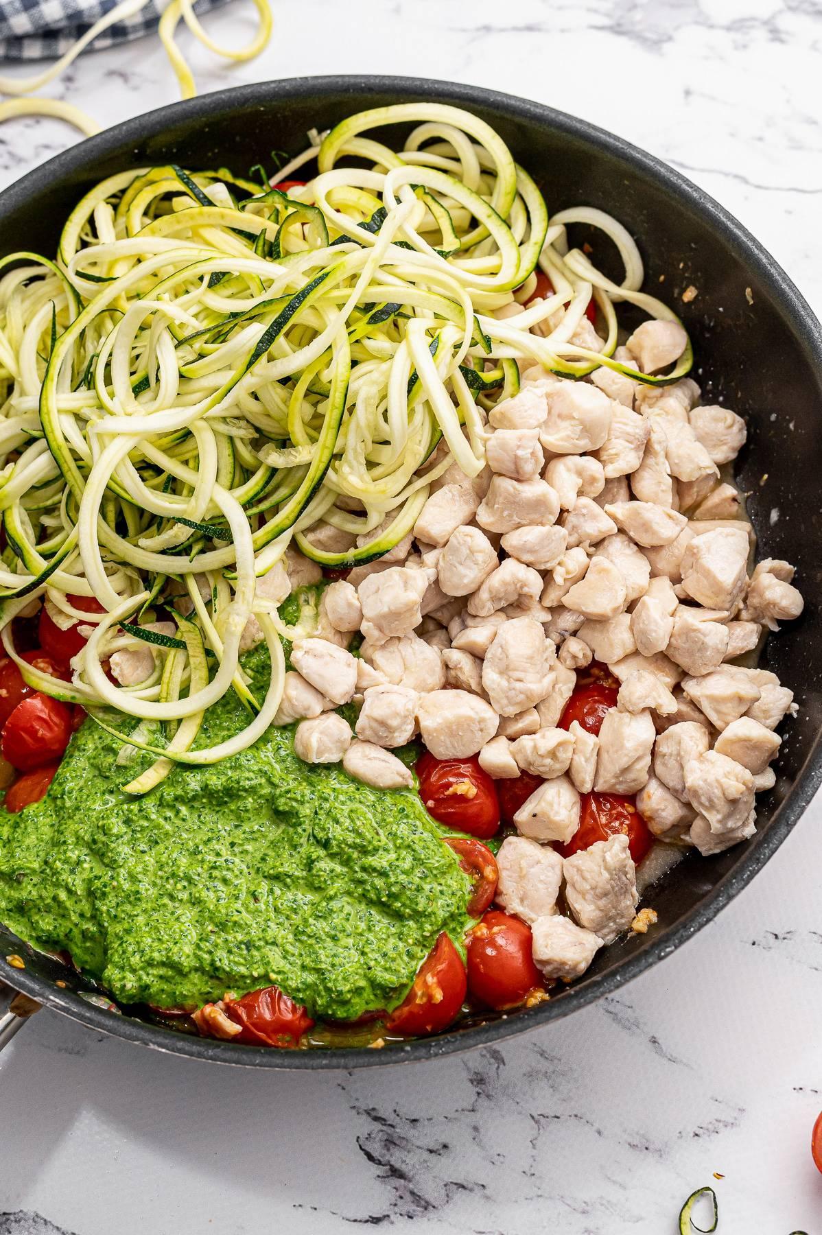 pesto noodle ingredients in a pan.