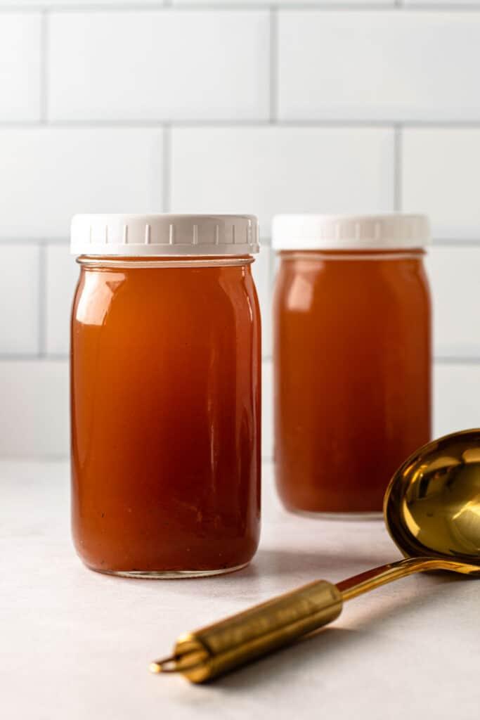 Homemade vegetable stock in jars.