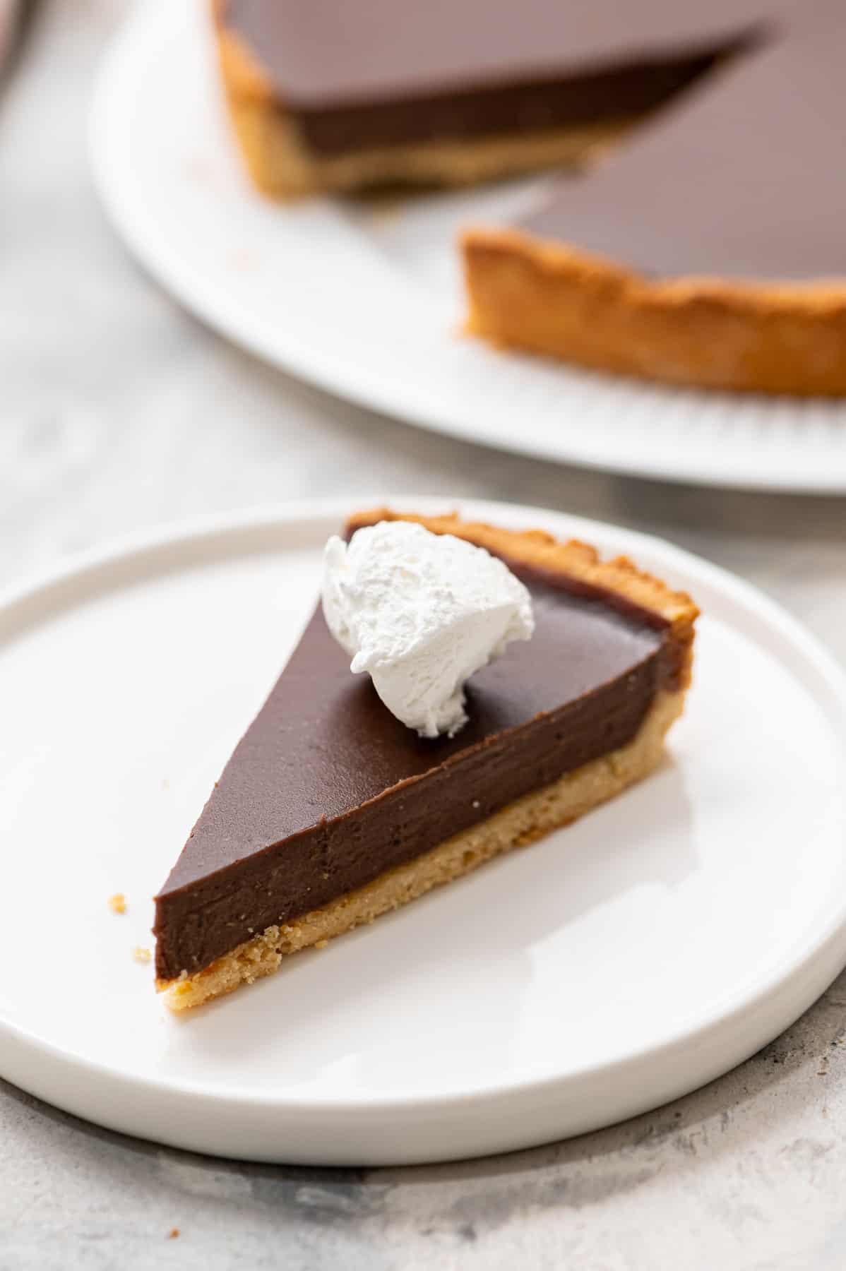 A slice of gluten-free chocolate tart.