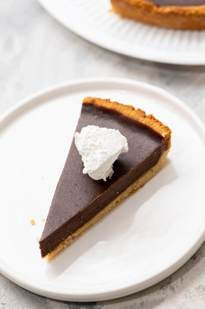 Gluten-free chocolate tart on a plate.