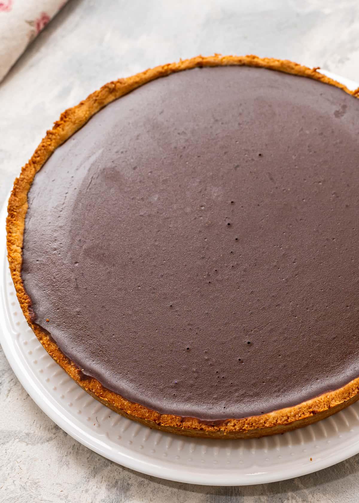 A gluten-free chocolate tart on a plate.