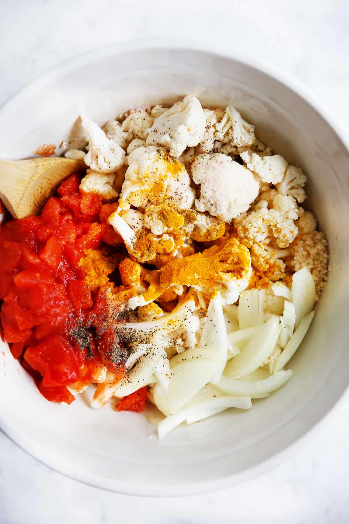 Ingredients for spiced cauliflower in a bowl.