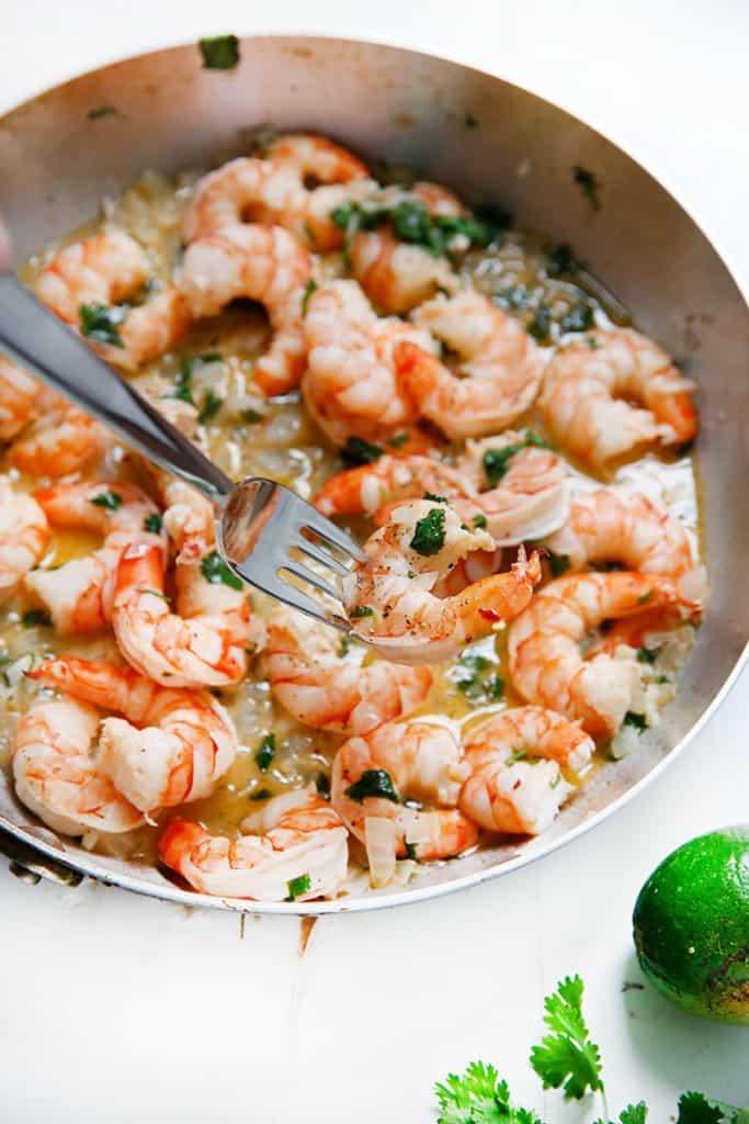 Fork holding shrimp