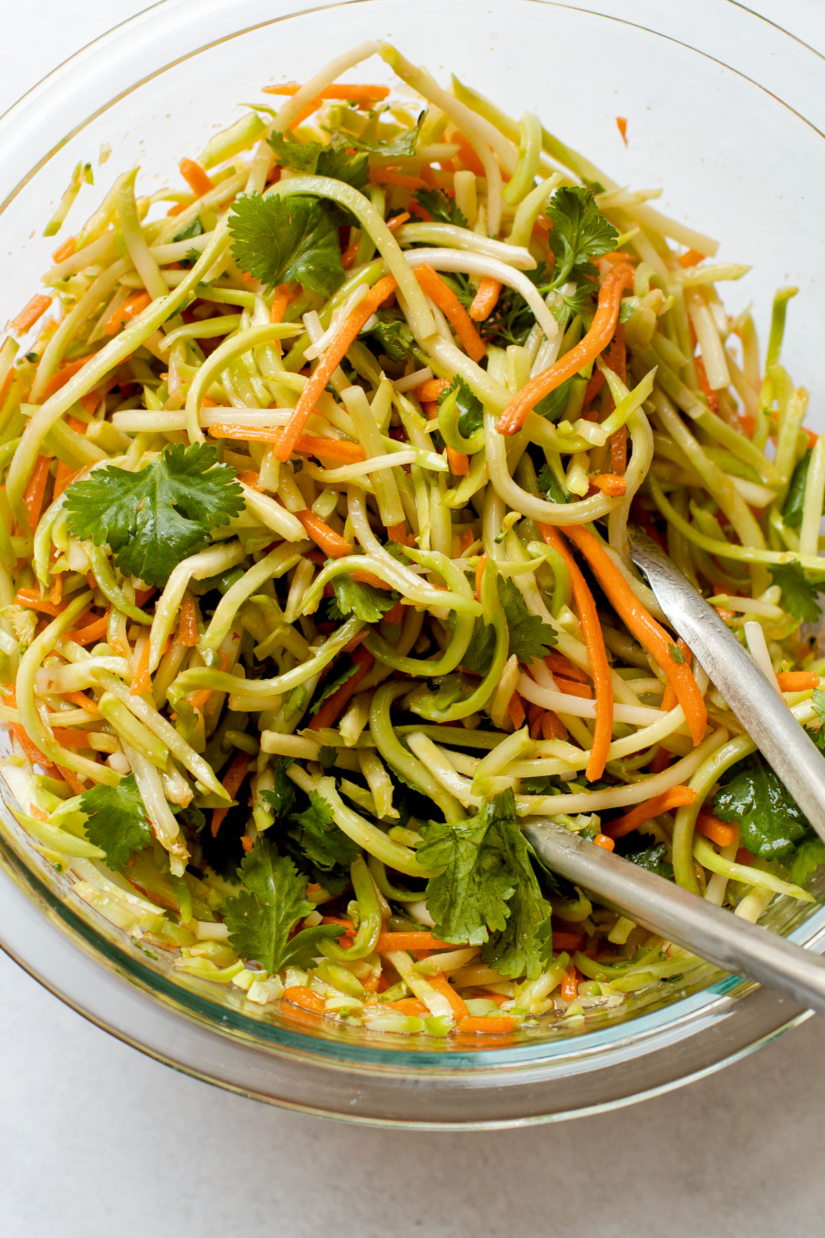 Easy broccoli slaw in a bowl for asian cabbage wraps.