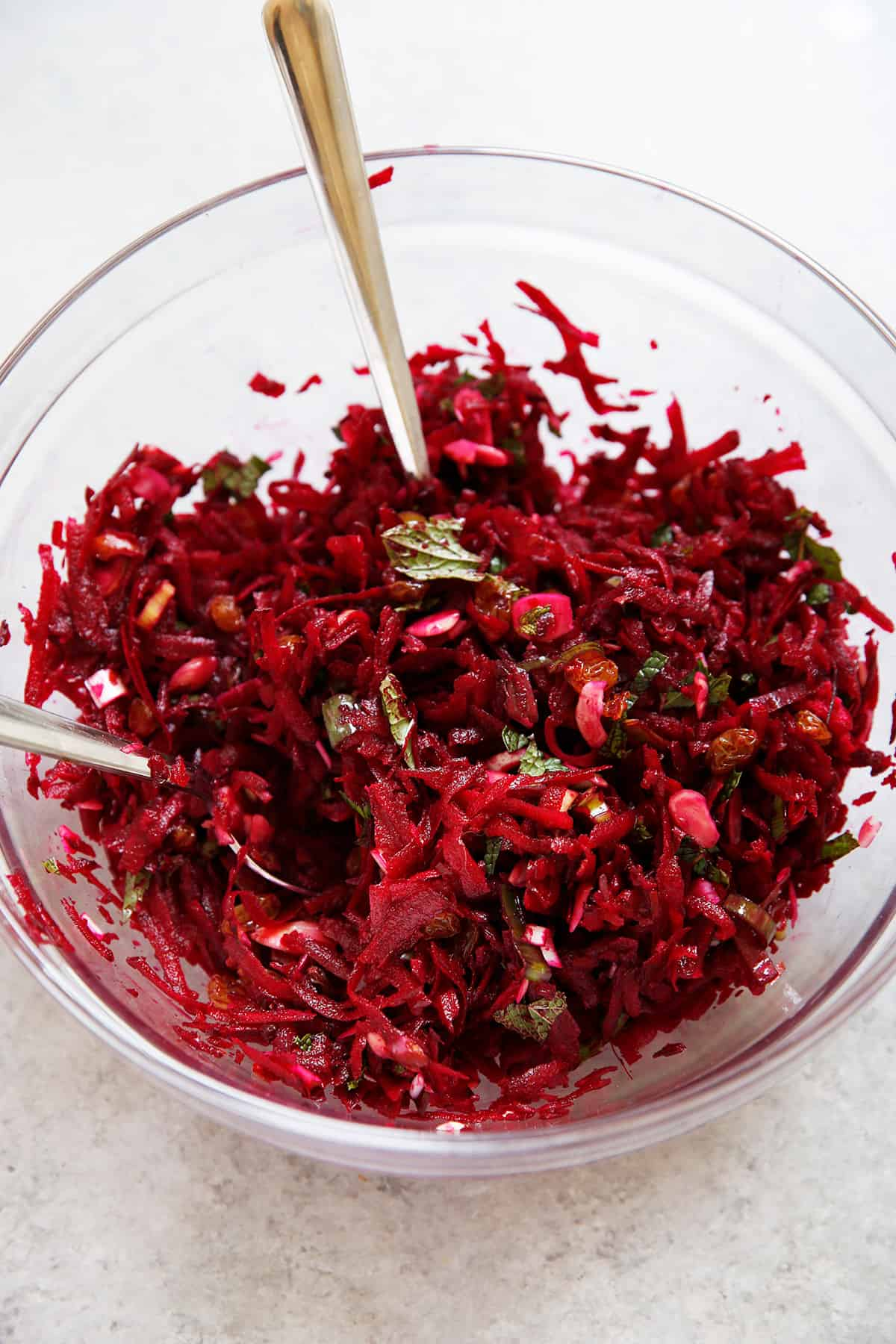 A bowl of beet slaw with ginger and mint.
