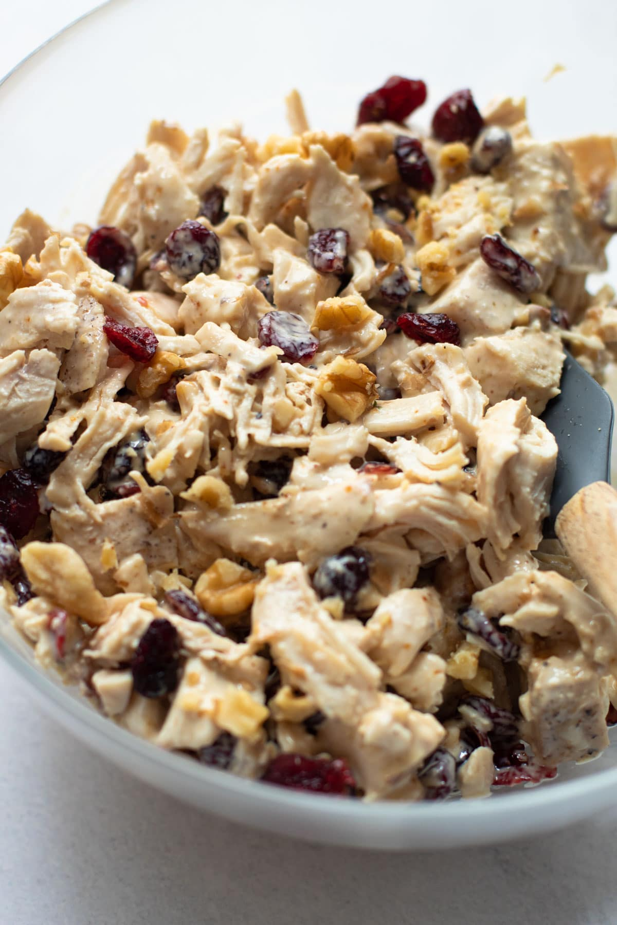 Chicken salad with walnuts and cranberries in a bowl.