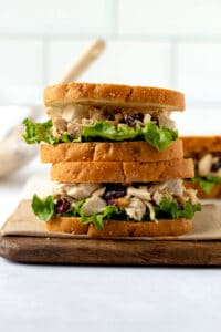 Cranberry Walnut Chicken Salad sandwiches stacked on top of one another.