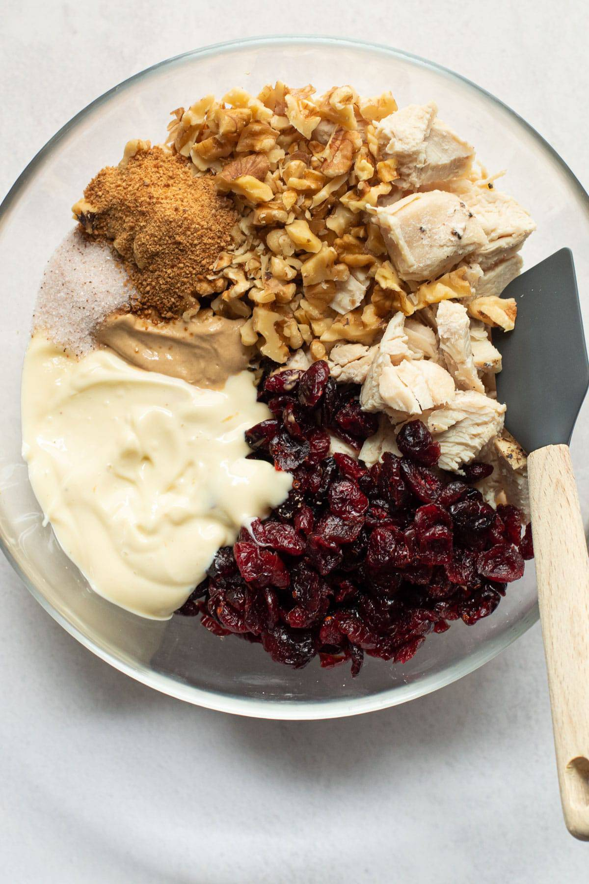 Ingredients for cranberry walnut chicken salad in a bowl.