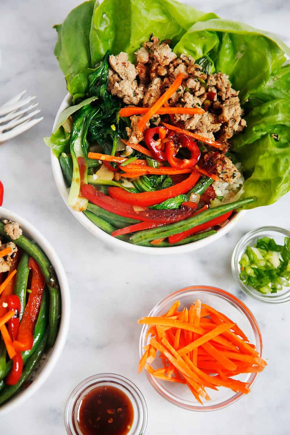 Thai Ground Turkey Bowl with lettuce and sliced carrots.