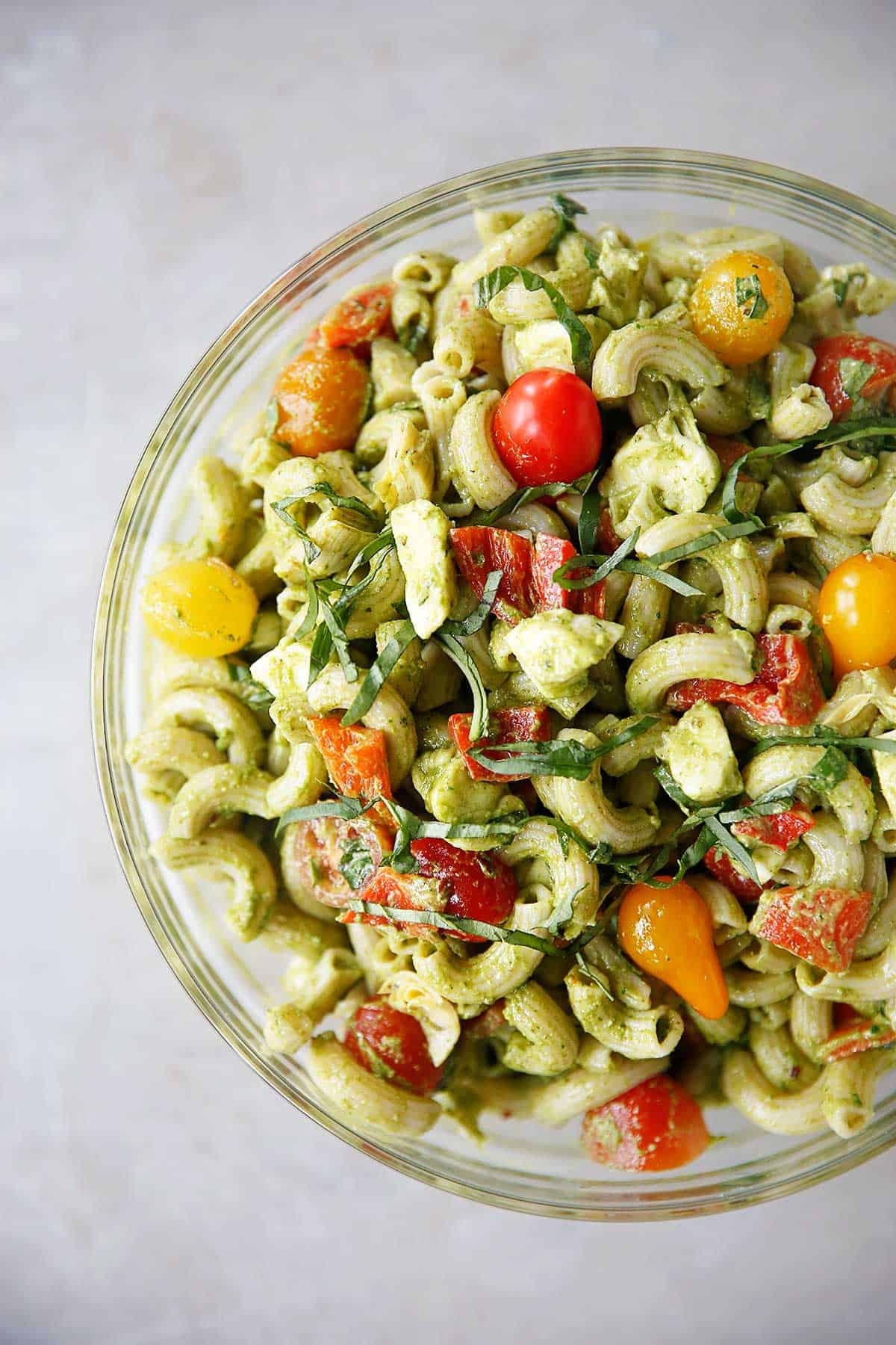 A bowl of caprese pesto pasta salad.