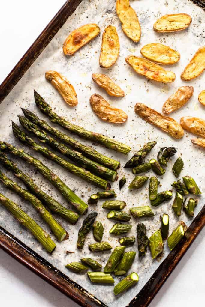 Roasted spring veggies on a sheet pan.