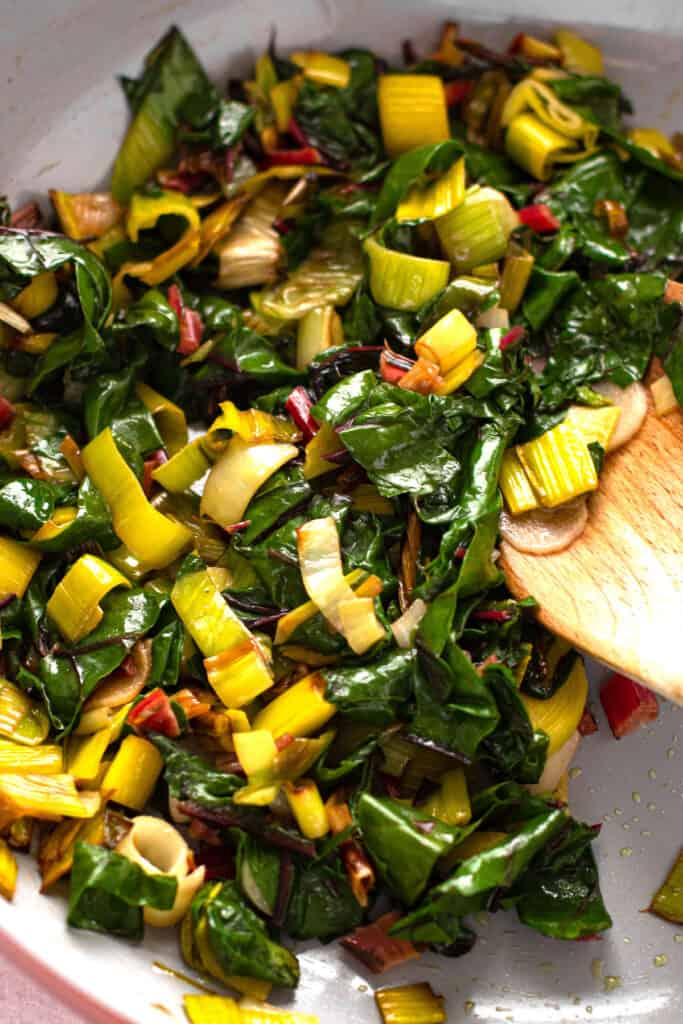 Swiss chard and leeks in a pan.