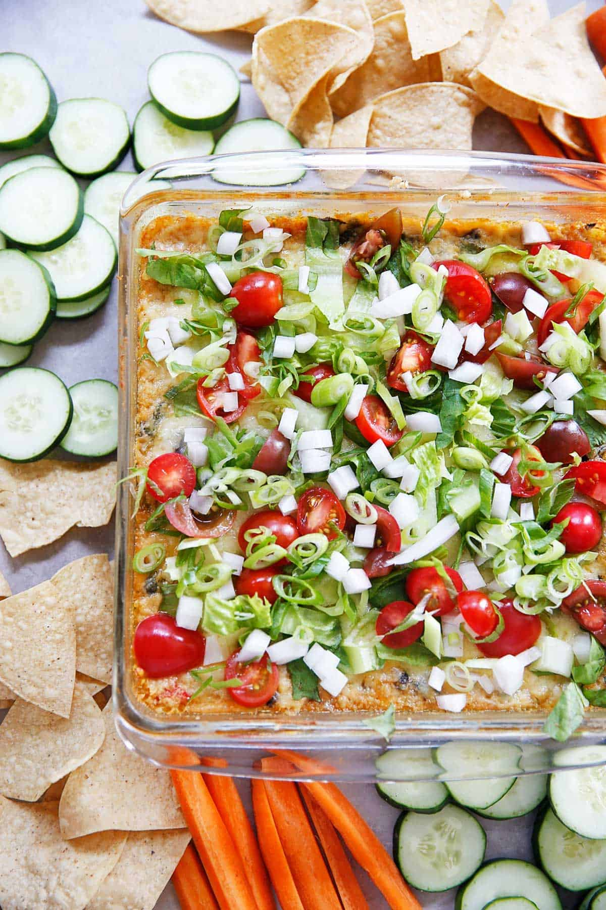 Southwest hummus with toppings in a baking dish