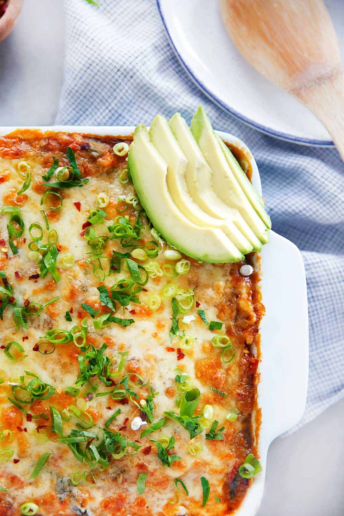 Cheesy top of casserole with avocado slices