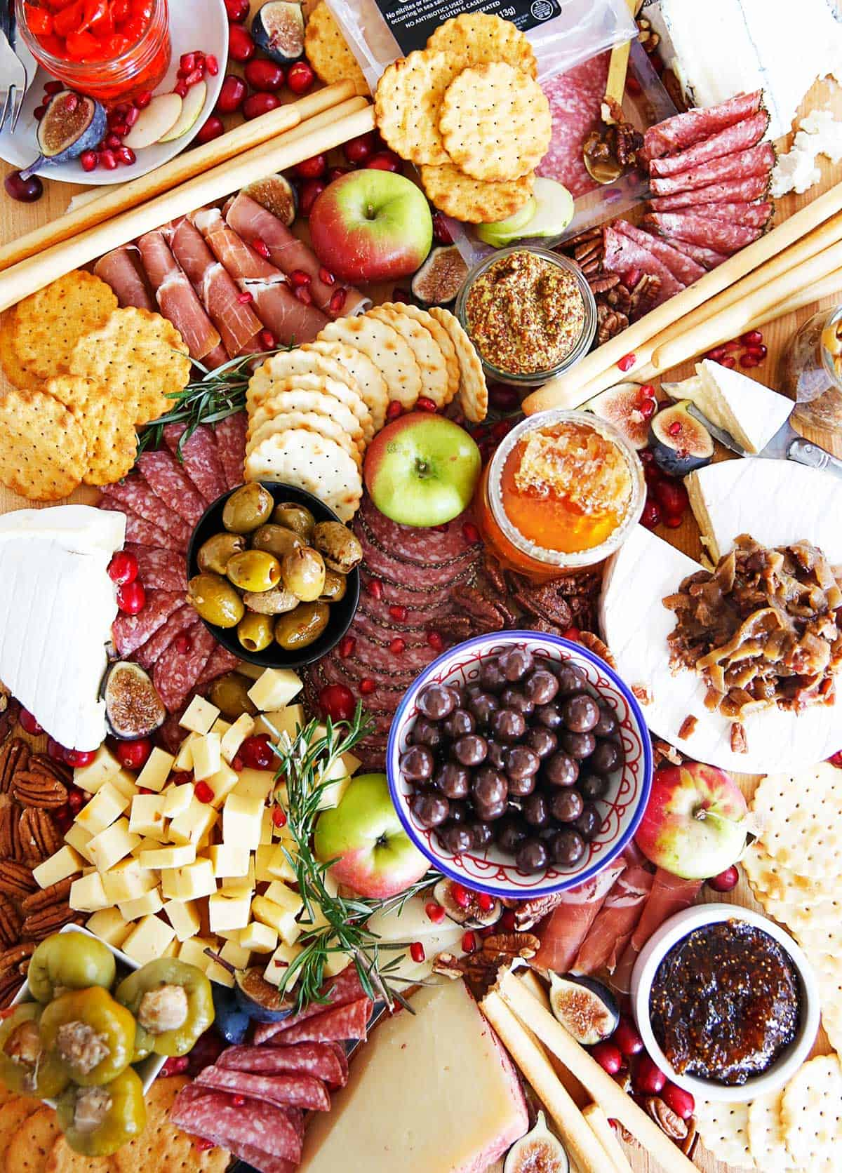 Charcuterie Board filled with meats, cheese and spreads.