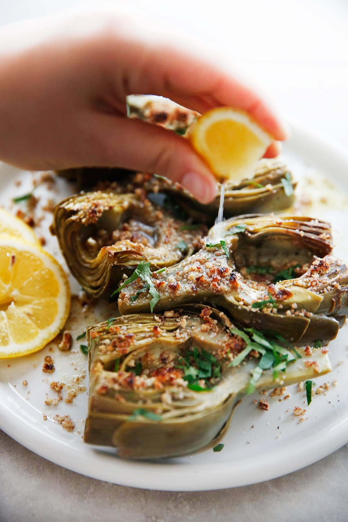 Braised Artichokes with Garlicky Pecan Bread Crumbs