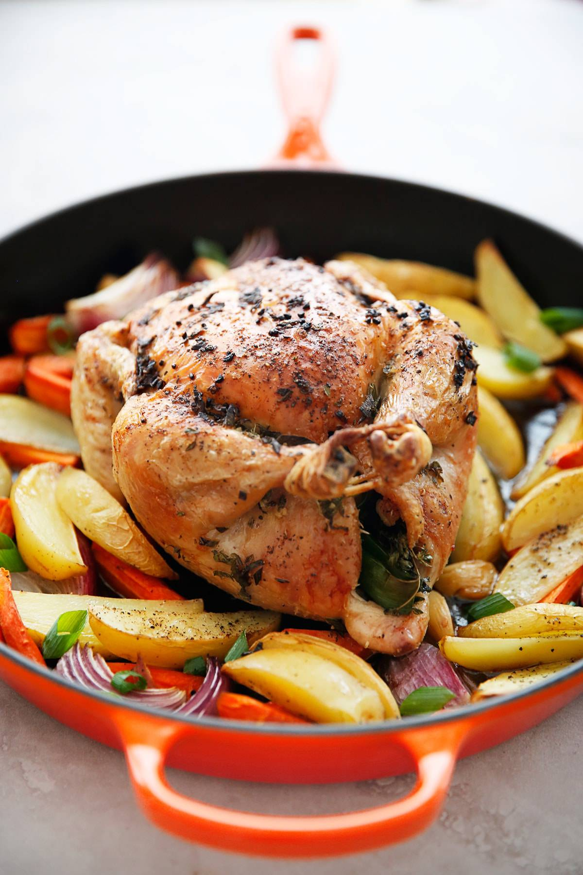 Whole chicken dinner in a skillet