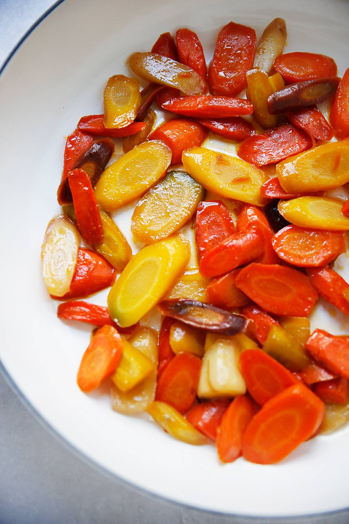 Honey glazed carrots in a pan