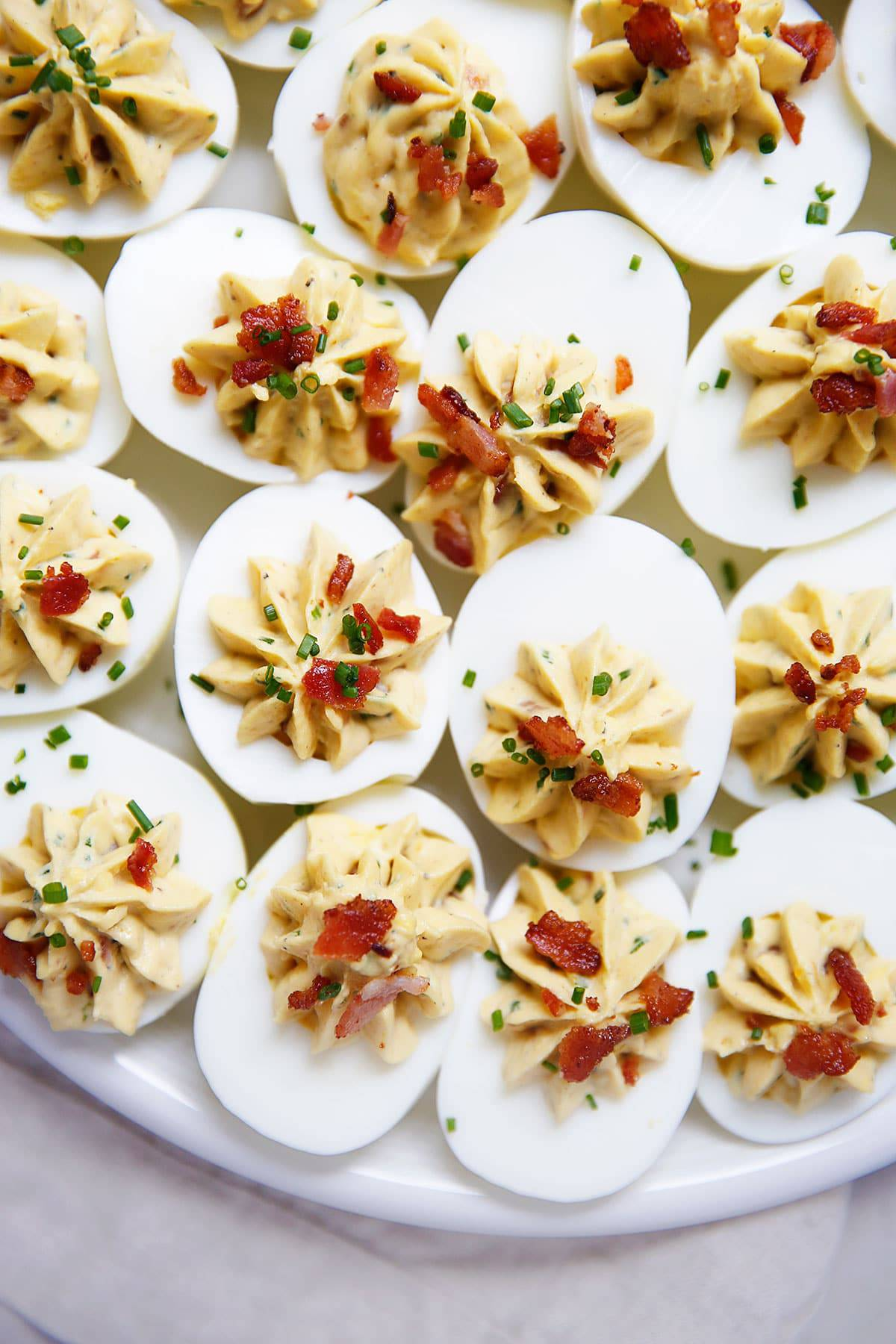 Best deviled eggs with bacon on a plate