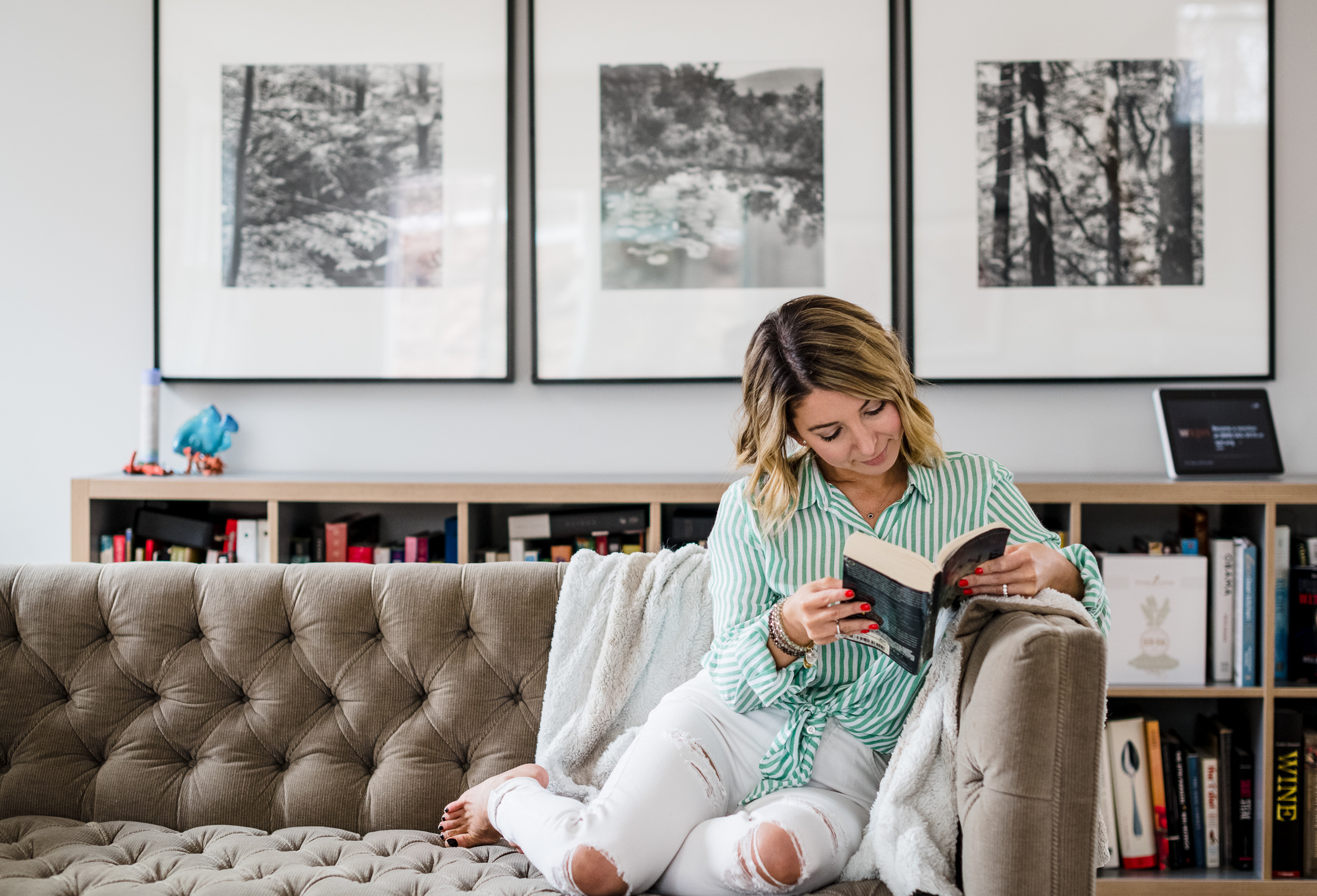 Reading the Best fall books on a couch