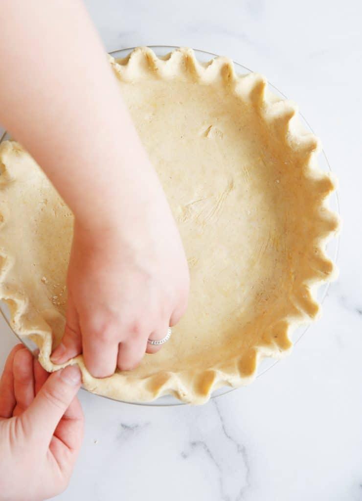 Pie crust in a plate.