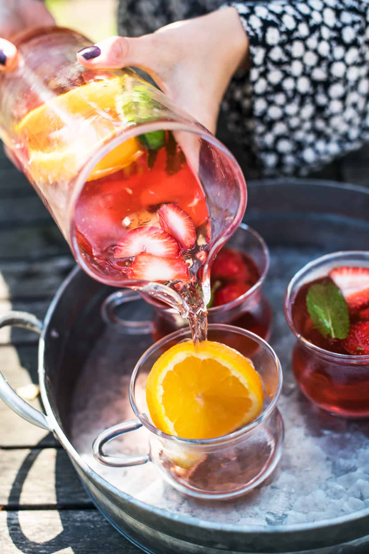 Pouring rose sangria easy