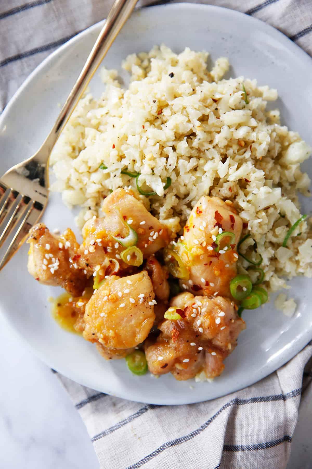 Paleo orange chicken with cauliflower rice on a plate