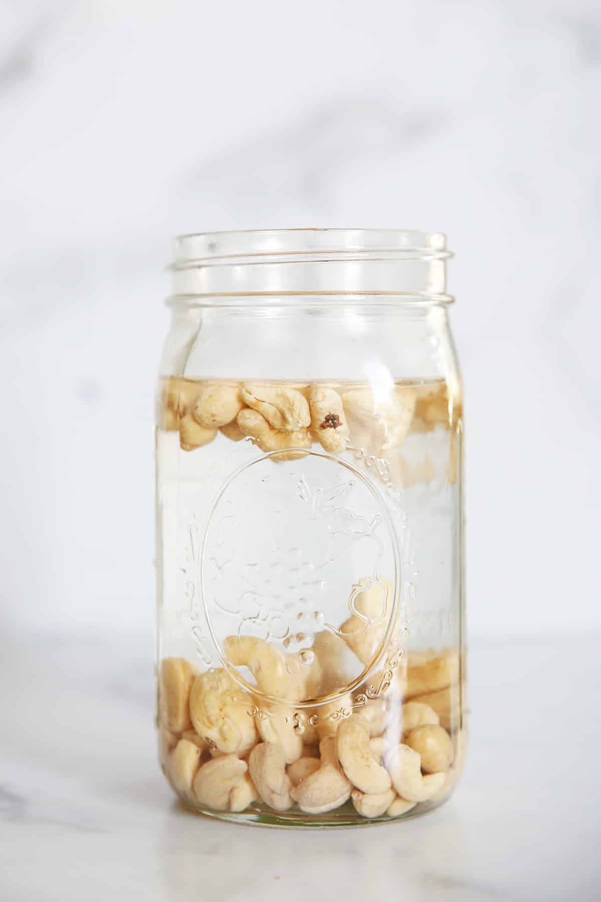 soaking cashews in a jar