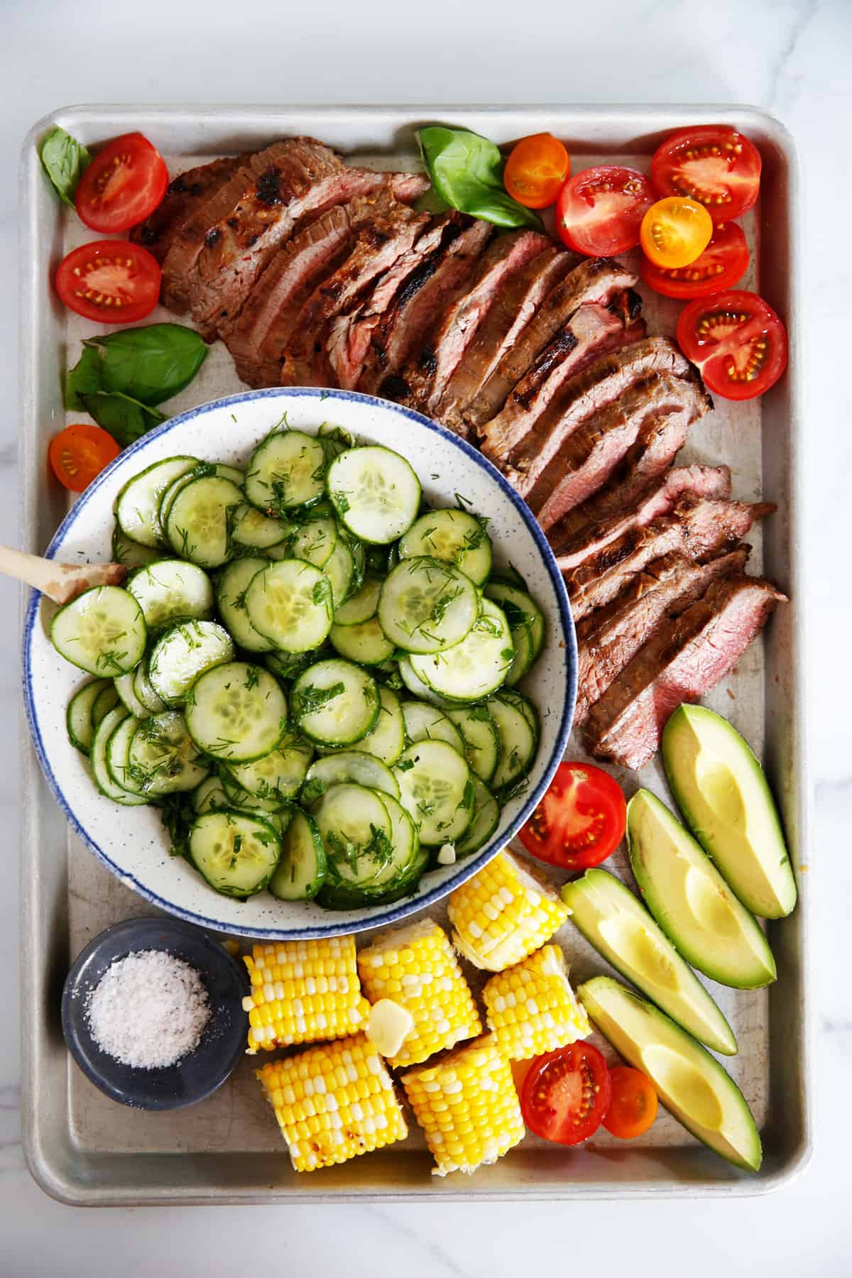 grilled flank steak with sides to serve