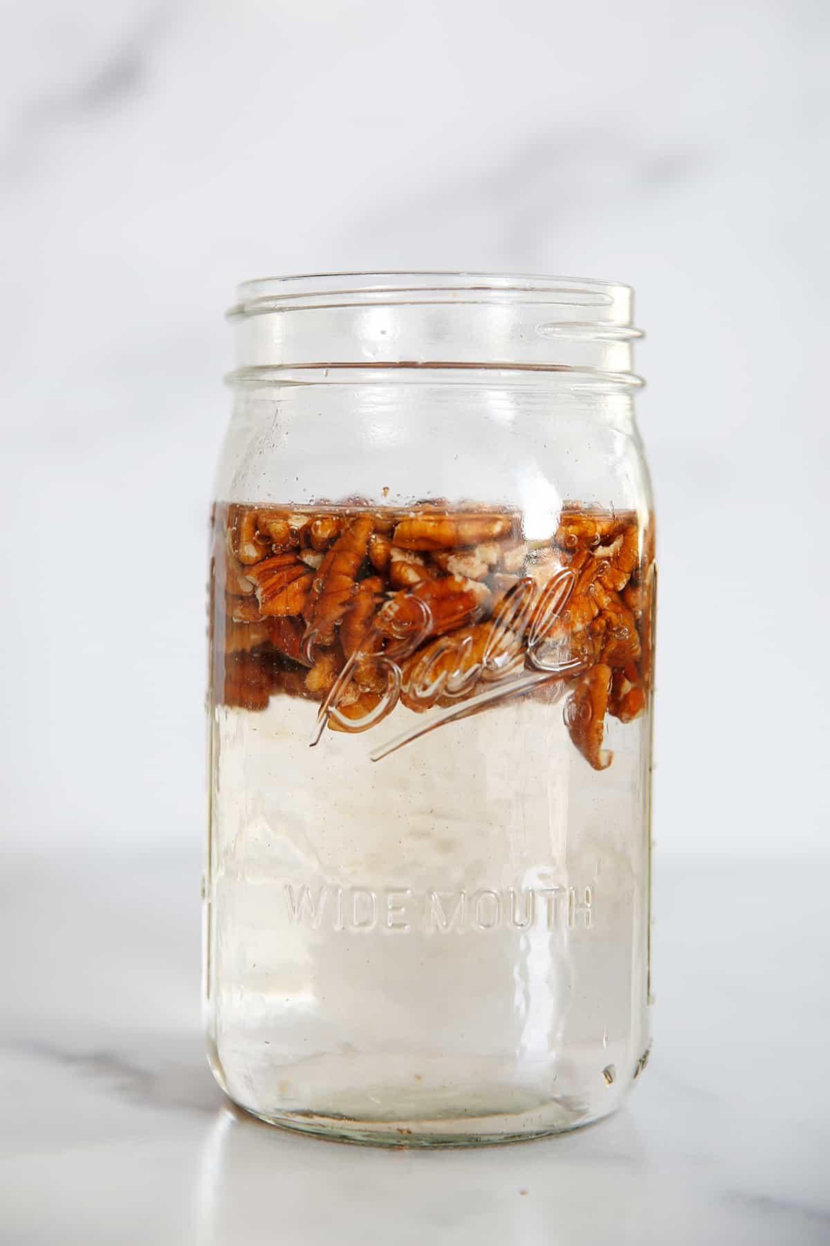 pecans soaking in a jar