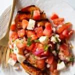 Bruschetta chicken on a plate.