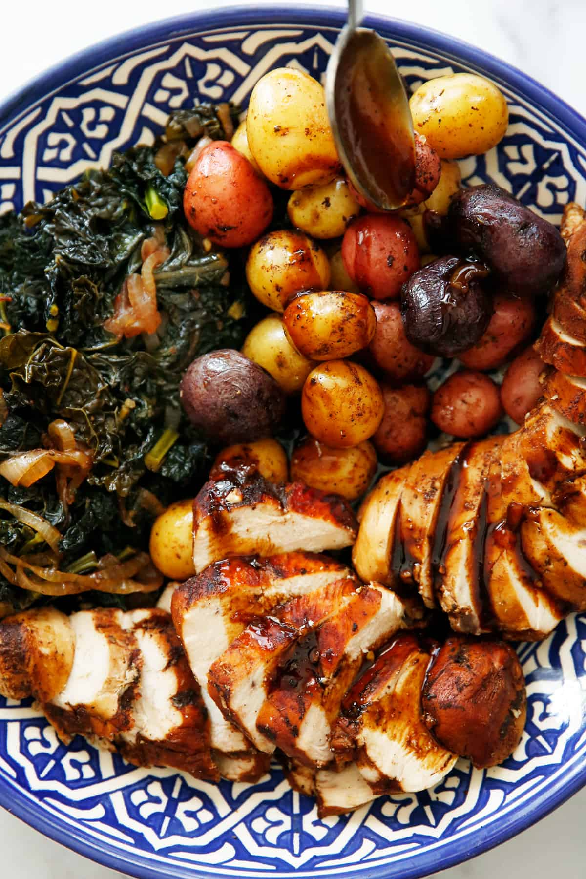 Instant Pot Balsamic Chicken on a platter with kale and potatoes.