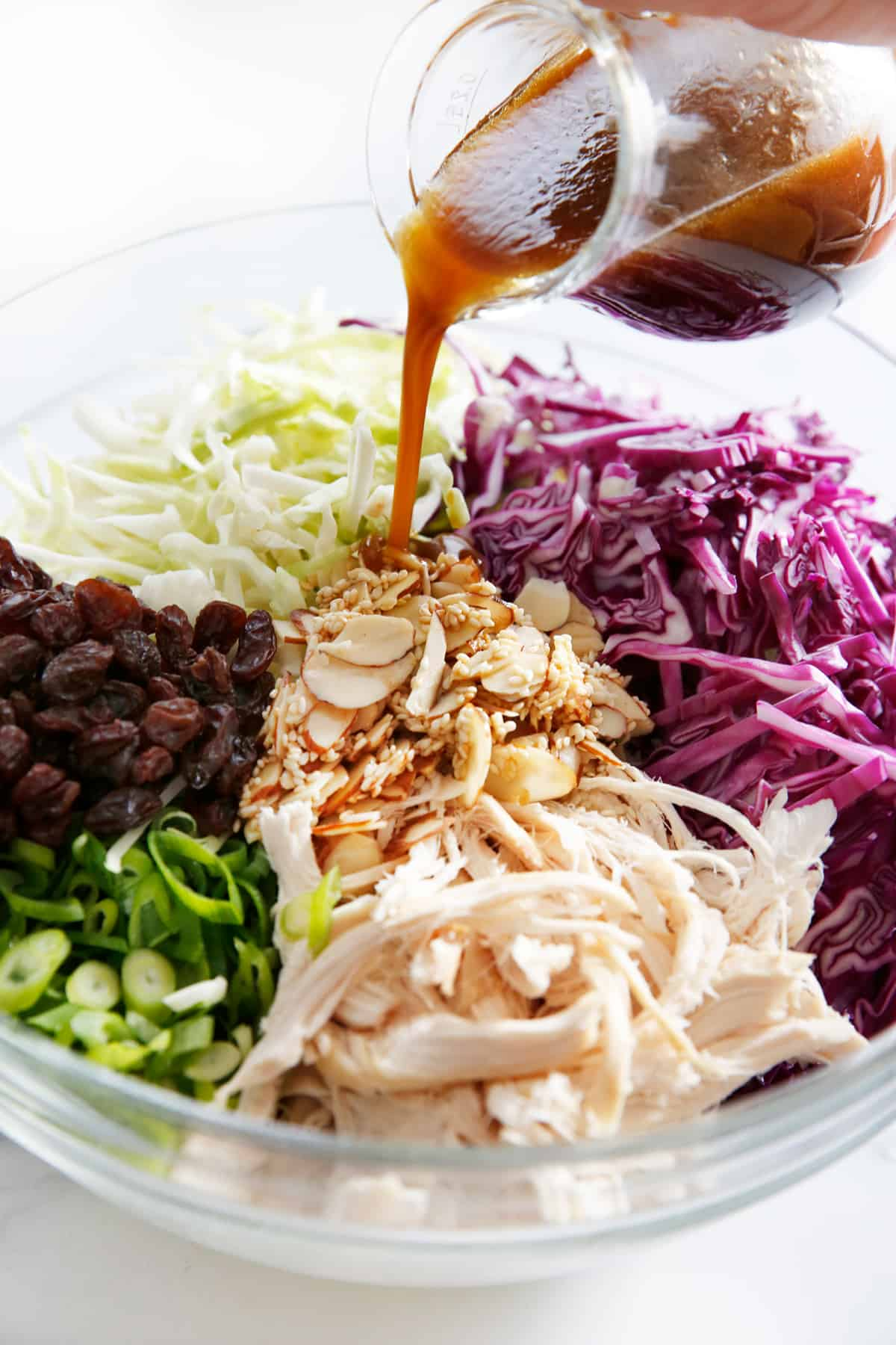 sweet sesame dressing poured over chicken Thai slaw