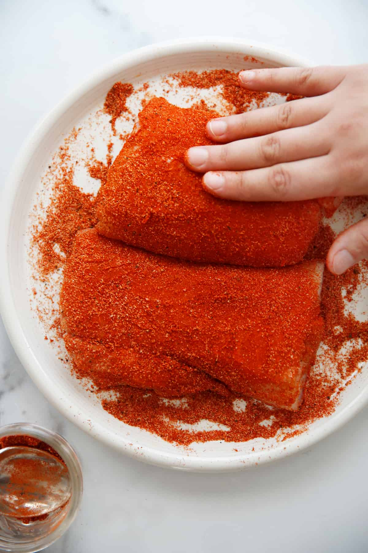 Rubbing the spice blend on the fish