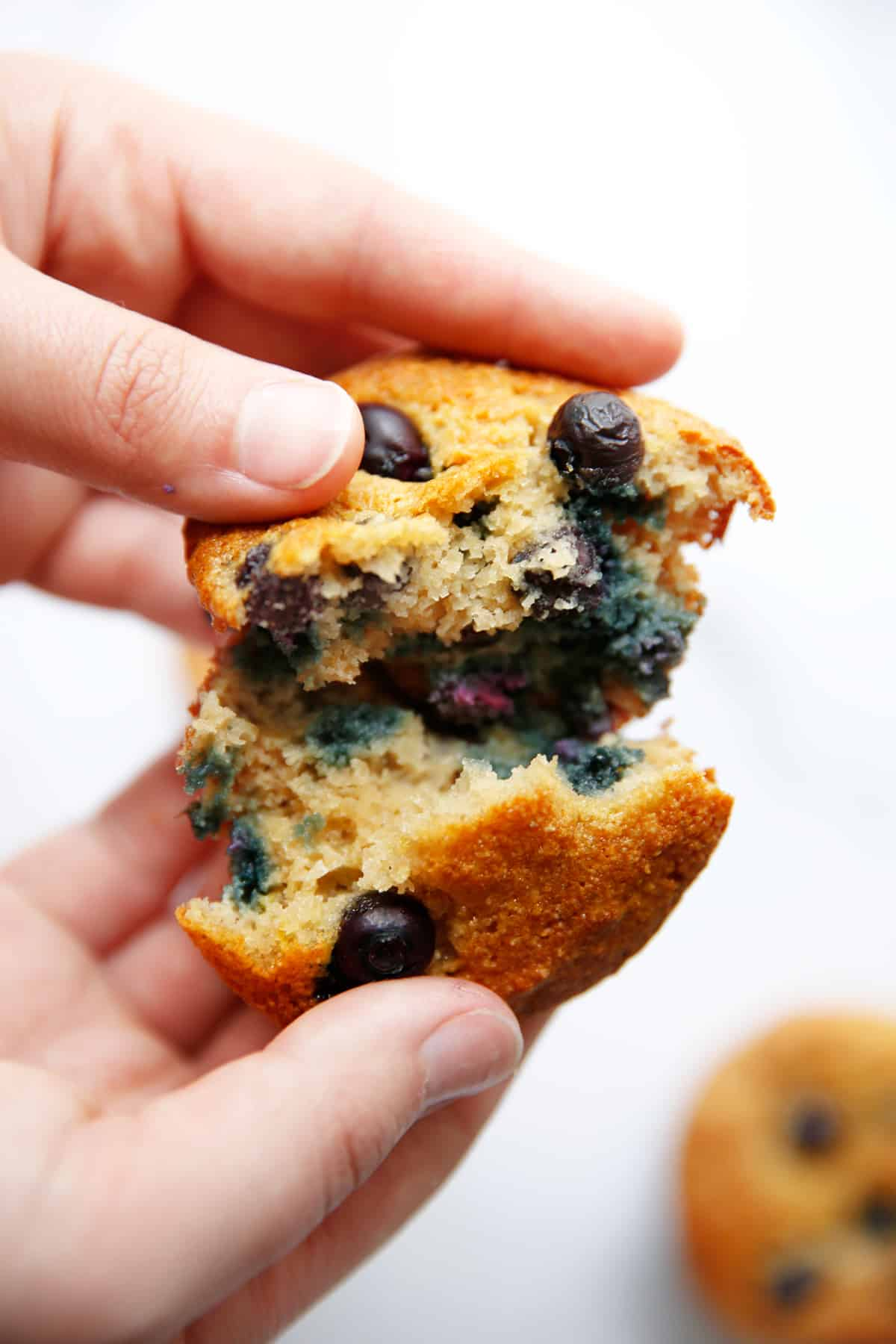 A paleo blueberry muffin ripped in half