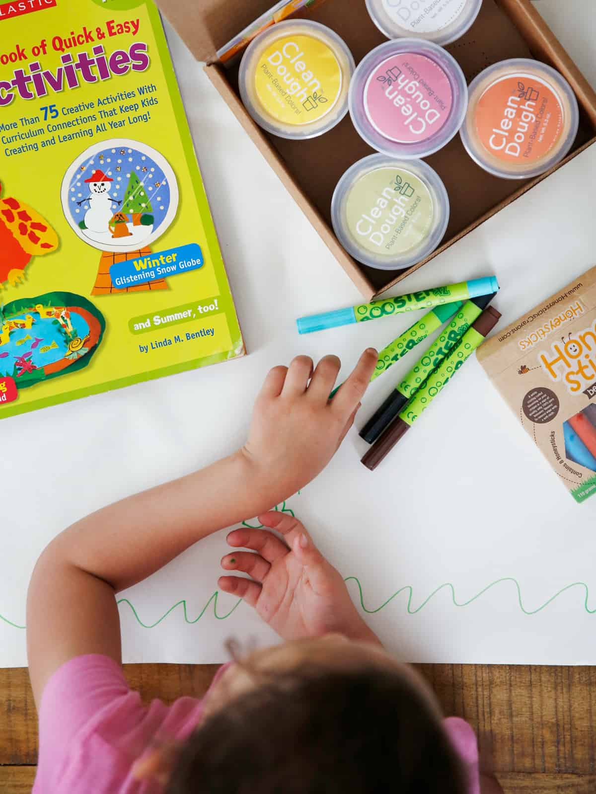 Girl coloring with non toxic art supplies