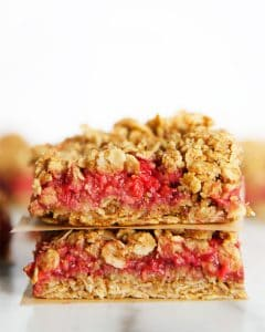Two raspberry oatmeal bars stacked up on each other.