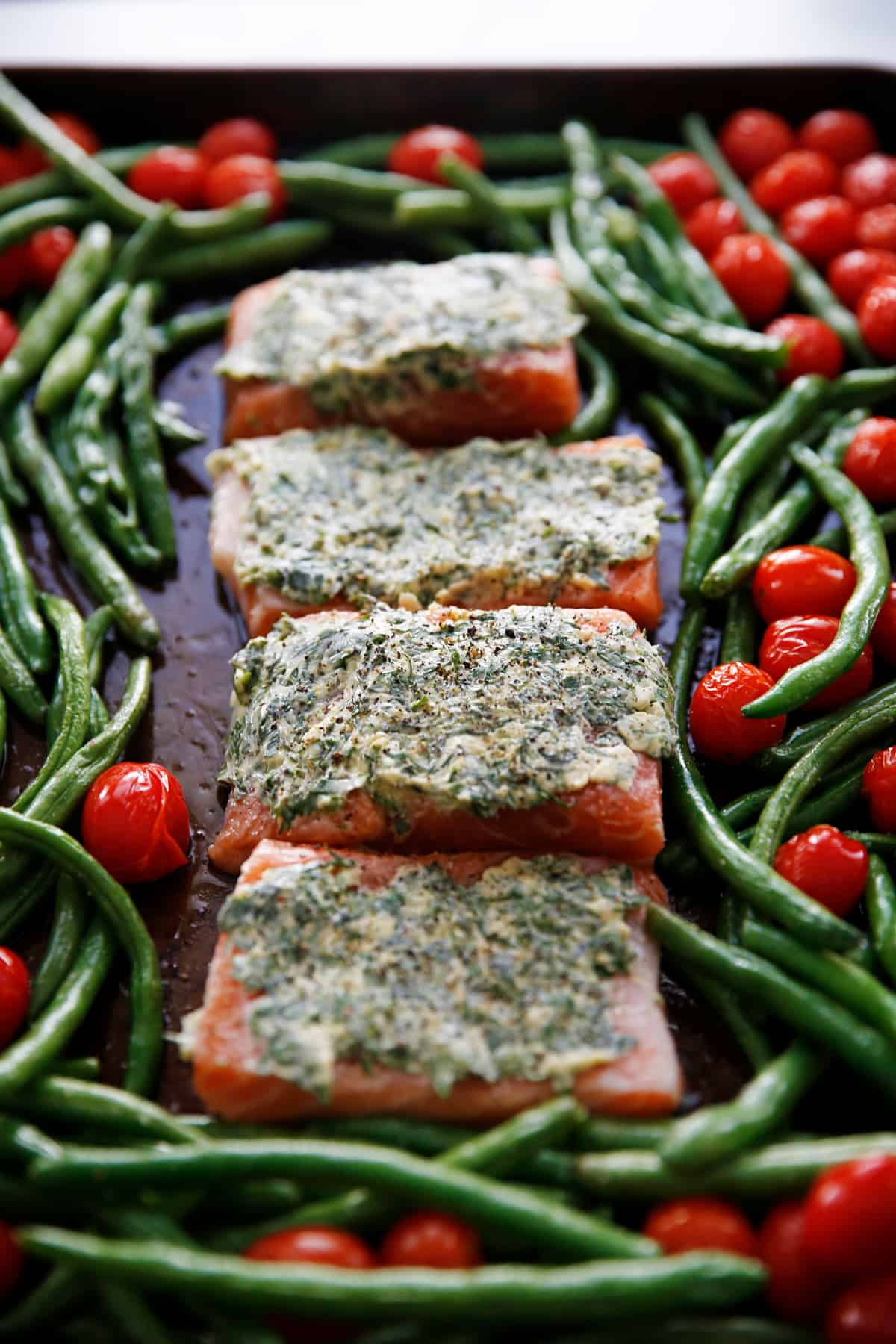 herb butter salmon with tomatoes
