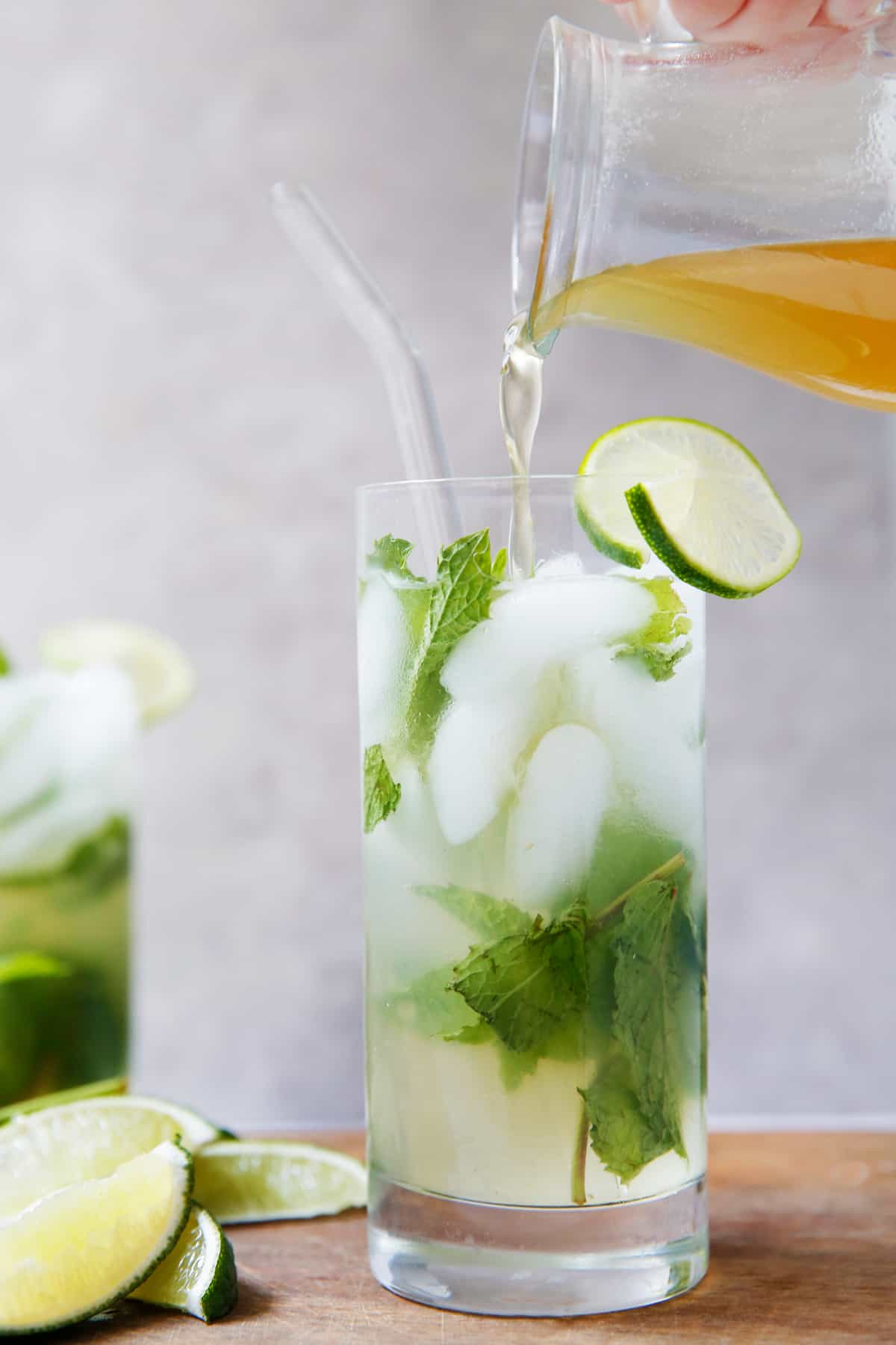 Pouring honey simple syrup into mojito